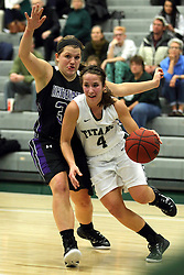 25 November 2014:  Rebekah Ehresman steps inside of Andrea Meinert during an NCAA women's division 3 CCIW basketball game between the Wisconsin Whitewater Warhawks and the Illinois Wesleyan Titans in Shirk Center, Bloomington IL