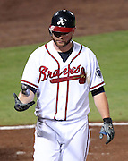 ATLANTA, GA - SEPTEMBER 02:  Catcher Brian McCann #16 of the Atlanta Braves flips his bat after striking out during the game against the Los Angeles Dodgers at Turner Field on September 2, 2011 in Atlanta, Georgia.  (Photo by Mike Zarrilli/Getty Images)