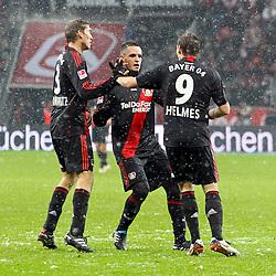 05.12.2010,  BayArena, Leverkusen, GER, 1. FBL, Bayer Leverkusen vs 1. FC Koeln, 15. Spieltag, im Bild: Stefan Reinartz (Leverkusen #3) (li.) und Eren Derdiyok (Leverkusen #19) (mi.) gratulieren Patrick Helmes (Leverkusen #9) (re.)  EXPA Pictures © 2010, PhotoCredit: EXPA/ nph/  Mueller       ****** out ouf GER ******