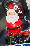 A Santa rests on back of a bike as members of the Delaware Valley Iron Indian Riders Association held their annual Ride Of the Santas and dropped off toys to children at  Saturday, December 21, 2019 at St Francis-St Vincent Home For Children in Bensalem, Pennsylvania. (Photo by William Thomas Cain / CAIN IMAGES)