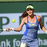 March 11, 2016, Palm Springs, CA:<br /> Agnieszka Radwanska in action against Dominica Sibulkova during the 2016 BNP Paribas Open at the Indian Wells Tennis Garden in Indian Wells, California Friday, March 11, 2016.<br /> (Photos by Billie Weiss/BNP Paribas Open)