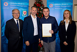 NEWPORT, WALES - Wednesday, December 12, 2018: Mark Roberts receives his certificate from Wales national team manager Ryan Giggs alongside Jean-Loup Chappelet, UEFA CFM Dean (L) and Valentina Mercolli, UEFA HatTrick Programme Manager (R) during the UEFA Certificate of Football Management Graduation Ceremony in the 2010 Clubhouse at the Celtic Manor Resort. (Pic by David Rawcliffe/Propaganda)