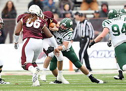 Louisiana-Monroe quarterback Kolton Browning (15) is tackle by Ohio defensive end Ty Branz. (73) during the second quarter of the Independence Bowl NCAA college football game in Shreveport, La., Friday, Dec. 28, 2012.