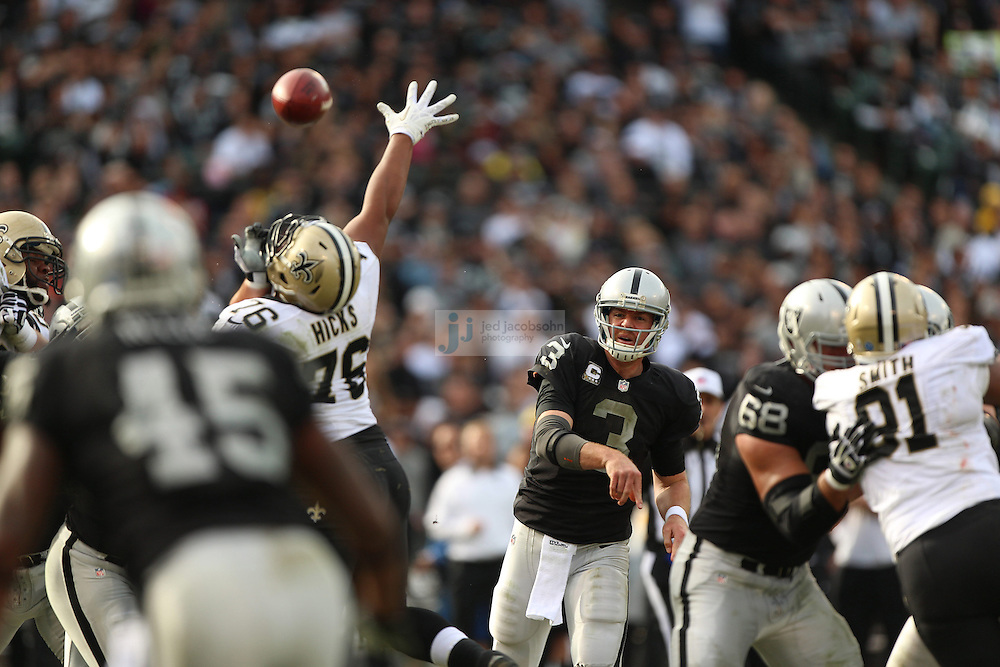 Oakland Raiders quarterback Carson Palmer (3) in action against the New Orleans Saints during an NFL game on Sunday, Nov. 18, 2012 at the Oakland Coliseum in Oakland, Ca. (AP Photo/Jed Jacobsohn)