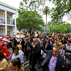 Apr 15, 2016; New Orleans, LA, USA; A second-line parade marches down Camp street near Half Moon Bay bar for a tribute march to the retired NFL athlete Will Smith memorial at Sophie B. Wright Place and Felicity Street. Smith was shot and killed late Saturday night at the memorial location after being involved in a minor traffic accident. Mandatory Credit: Derick E. Hingle-USA TODAY Sports