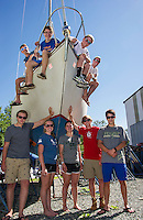 Lake Winnipesaukee Sailing Association instructors surround an Alberg 30 Cruising Yacht donated annonomously to their club. (l-r top side)  Junior Director Liam Shanahan, Dawson Ellis, Chris Yopp and Junior Director Ben Crosby.  (l-r standing) Morgan Himmer, Catherine McLaughlin, Elizabeth McCabe, Wyatt Himmer and Shamih Shafique.   (Karen Bobotas/for the Laconia Daily Sun)