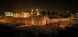 © Licensed to London News Pictures. 04/11/2018. London, UK. Thousands of individual flames illuminate the moat of The Tower of London in an installation entitled 'Beyond the Deepening Shadow: The Tower Remembers'. This public act of remembrance for the lives of the fallen, honouring their sacrifice will run for eight nights, leading up to and including the Centenary Armistice Day 2018. The evolving installation will unfold each evening over the course of four hours, with the Tower moat gradually illuminated by individual flames. A specially-commissioned sound installation 'a sonic exploration of the shifting tide of political alliances, friendship, love and loss in war' will be played. At the centre of the sound installation lies a new choral work, with words from war poet Mary Borden's Sonnets to a Soldier. Photo credit: Peter Macdiarmid/LNP