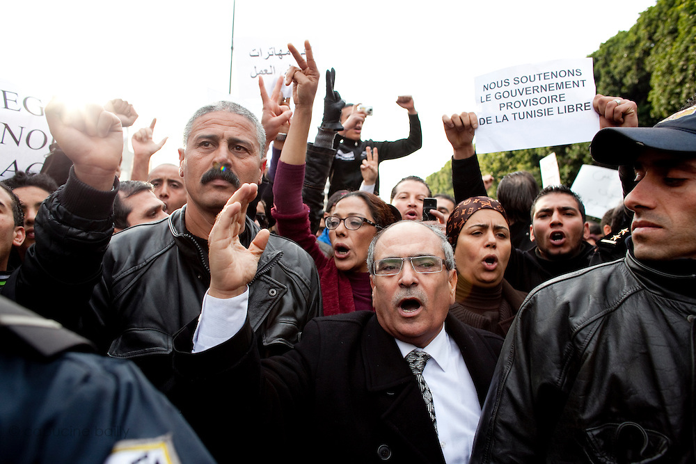 Tunis, Tunisia. January 25th 2011.Pro-government protesters on Avenue Bourguiba support the interim government formed after the ousting of president Zine al-Abidine Ben Ali last January 14th.....