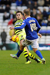 Yeovil Town's Joe Ralls challenges for the ball with  Birmingham City's Brain Howard - Photo mandatory by-line: Dougie Allward/JMP - Tel: Mobile: 07966 386802 18/01/2014 - SPORT - FOOTBALL - St Andrew's Stadium - Birmingham - Birmingham City v Yeovil Town - Sky Bet Championship