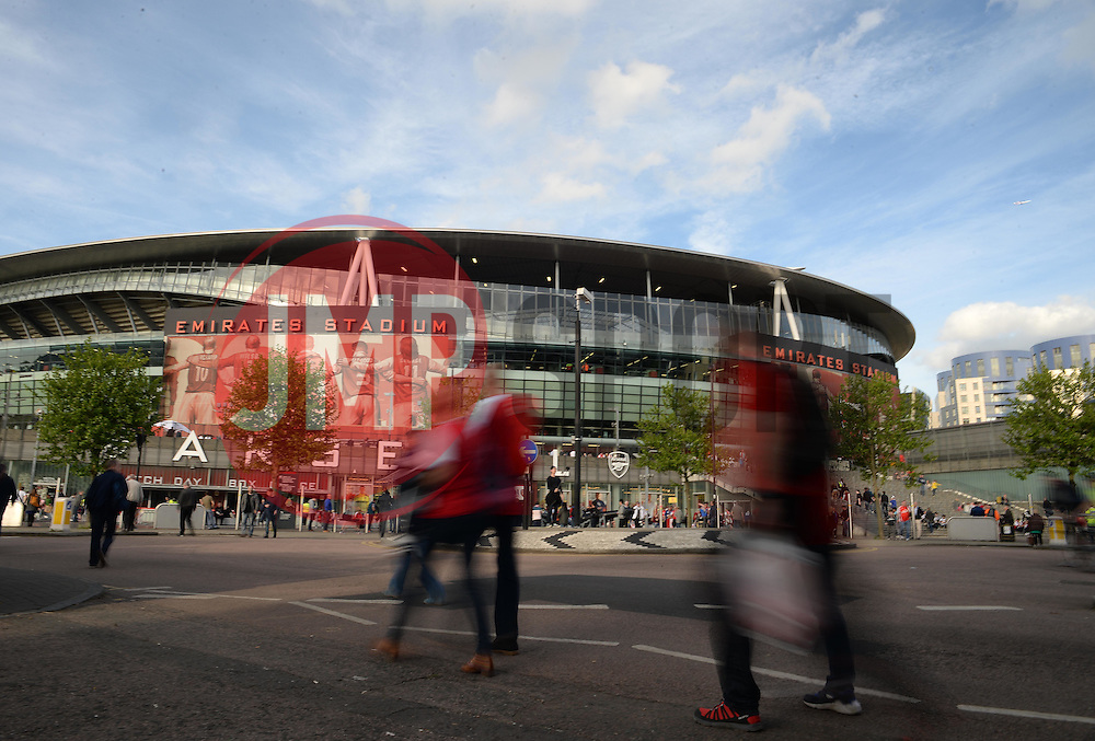 Arsenal Fans make there way to the Emirates Stadium. - Photo mandatory by-line: Alex James/JMP - Mobile: 07966 386802 - 11/05/2015 - SPORT - Football - London - Emirates Stadium - Arsenal v Swansea City - Barclays Premier League
