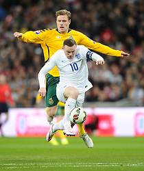 Wayne Rooney of England (Manchester United) races through on goal but hits the post  - Photo mandatory by-line: Joe Meredith/JMP - Mobile: 07966 386802 - 27/03/2015 - SPORT - Football - London - Wembley Stadium - England v Lithuania - UEFA EURO 2016 Qualifier