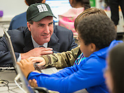 Code.org COO Cameron Wilson watches students work a coding exercise during an Hour of Code at Kolter Elementary School, December 10, 2014.