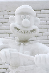 Snow sculpture of Wallace from animated film Wallace and Gromit at annual snow sculpture festival in Sapporo Japan