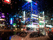 Daegu/South Korea, Republic Korea, KOR, 07.09.2010: Street life during rain seen from a bus in the South Korean city of Daegu.