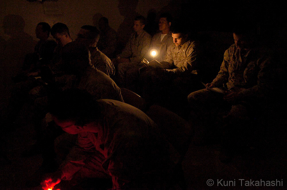 Soldiers of 2nd Battalion 24th Marines pray during sunday service at U.S Marine's Camp St. Michael near Mahmoudiya, Feb 2005.