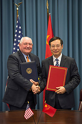 September 7, 2017 - Washington, DC, United States of America - U.S. Department of Agriculture Secretary Sonny Perdue, left, shakes hands with Chinese FDA Minister Bi Jingquan  after signing a memorandum of understanding to cooperate on food safety at the Department of Agriculture September 7, 2017 in Washington, D.C. (Credit Image: © Preston Keres/Planet Pix via ZUMA Wire)