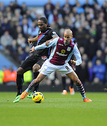 Crystal Palace's Cameron Jerome battles for the ball with Aston Villa's Karim El Ahmadi - Photo mandatory by-line: Joe Meredith/JMP - Tel: Mobile: 07966 386802 26/12/2013 - SPORT - FOOTBALL - Villa Park - Birmingham - Aston Villa v Crystal Palace - Barclays Premier League