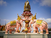 12 MARCH 2015 - BANGKOK, THAILAND:  A statue of Thai royal elephants in an intersection in front of the City Pillar Shrine in Bangkok. Bangkok's city pillar shrine (also known as San Lak Muang) is one of the most important city pillar shrines in Thailand. The shrine is in the heart of Bangkok, opposite the grand palace in the southeast corner of the Sanam Luang and close to the Ministry of Defence. The shrine was built after the establishment of the Rattanakosin Kingdom (Bangkok) to replace the old capital of the Thonburi Kingdom during the reign of King Rama I in 1782. It was intended to be the spiritual center for Thai citizens.     PHOTO BY JACK KURTZ