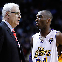 10 March 2011: Los Angeles Lakers shooting guard Kobe Bryant (24) talks to Lakers head coach Phil Jackson during the Miami Heat 94-88 victory over the Los Angeles Lakers at the AmericanAirlines Arena, Miami, Florida, USA.