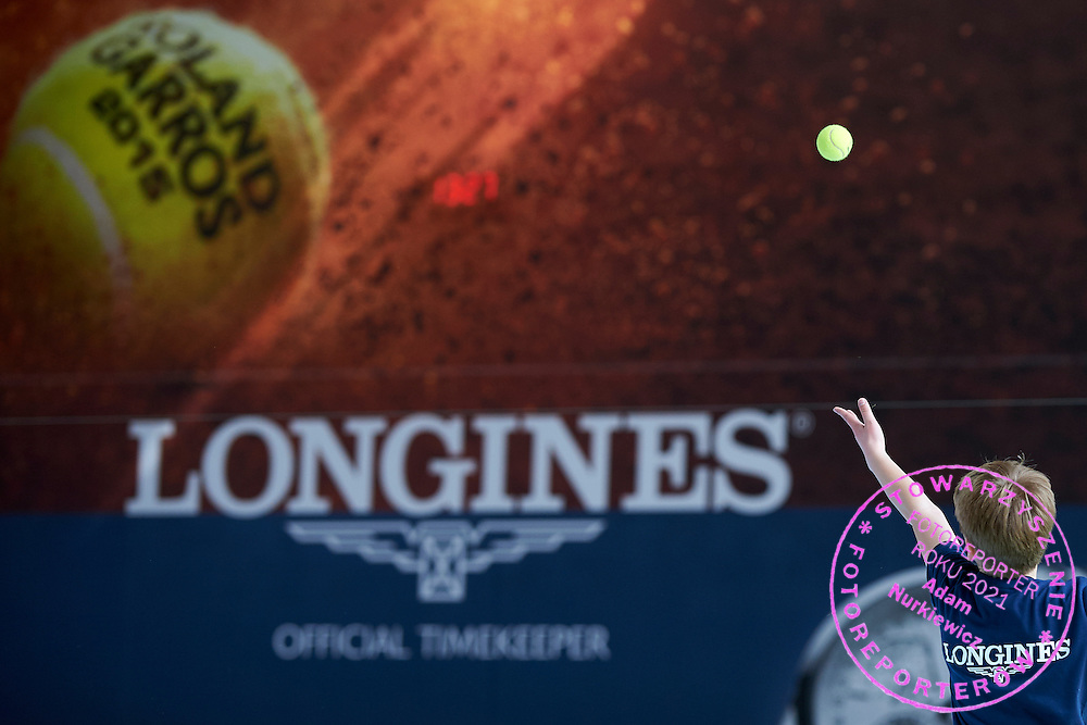 Maksymilian Kasnikowski from Poland under-14 tennis player competes during the Longines Future Tennis Aces 2015 at Tuan Tennis Club in Jozefoslaw near Warsaw on April 11, 2015.<br /> <br /> Poland, Warsaw, April 11, 2015<br /> <br /> Picture also available in RAW (NEF) or TIFF format on special request.<br /> <br /> For editorial use only. Any commercial or promotional use requires permission.<br /> <br /> Mandatory credit:<br /> Photo by &copy; Adam Nurkiewicz / Mediasport