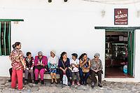 Villa De Leyva, Colombia  - February 8, 2017 : Women sitting and talking Villa de Leyva Boyaca in Colombia South America