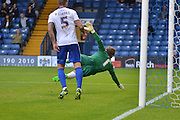 Christian Walton is called into action during the Sky Bet League 1 match between Bury and Fleetwood Town at Gigg Lane, Bury, England on 18 August 2015. Photo by Mark Pollitt.