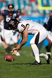 Texas Tech punter Jonathan LaCour (9) picks up the ball after it is snapped over his head on a punt attempt.  The Texas Tech Red Raiders defeated the Virginia Cavaliers 31-28 in the 2008 Konica Menolta Gator Bowl held at the Jacksonville Municipal Stadium in Jacksonville, FL on January 1, 2008.