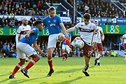 Christian Burgess (6) of Portsmouth battles for possession with Alex Gilliead (17) of Bradford City in the Portsmouth box during the EFL Sky Bet League 1 match between Portsmouth and Bradford City at Fratton Park, Portsmouth, England on 28 October 2017. Photo by Graham Hunt.
