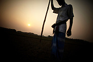 A farmer working his fields in Betua.?This area in the south of Bangladesh has been called ground zero of climate-change due to heavy river and ocean erosion. The lowlying area is also hugely affected by cyclones and rising sea-levels...By the Mouth of Ganges, at the Bay of Bengal is the Island of Bhola. This home of about two million people is considered to be ground zero of climate change. Half the island has disappeared in the past 40 years, and according to scientists the pace is not going to slow down. People pack up and leave as the water get closer. Some to a nearby embankment, while those with enough money move further inland, but for most life move on until the inevitable. It's always about survival for the people in one of the worlds poorest countries...Photo by: Eivind H. Natvig/MOMENT