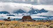 The barn at John Moulton Homestead, at the corner of Mormon Row and Antelope Flats Road, in the valley of Jackson Hole, Grand Teton National Park, Wyoming, USA. This image was stitched from multiple overlapping photos.