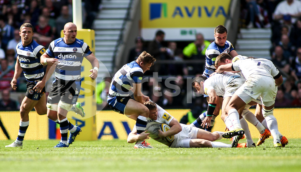 Chris Ashton of Saracens is tackled during the 2015 Aviva Premiership Rugby Final match between Bath Rugby and Saracens at Twickenham Stadium, on 30 May 2015. Photo by Ken Sparks.