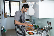 Italian author David Bez at home in North London preparing a salad. He published Salad Love recently which will be translated in 21 languages.