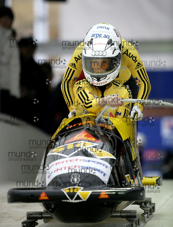 (November 21, 2009) Sabina Hafner (front) and Marina Gilardoni of Swizterland push in the first run en route to a 9th place finish at  the Federation Internationale de Bobsleigh et de Togogganing (FIBT) two-man men's bobsled World Cup race at the Olympic Sports Complex in Lake Placid, New York.