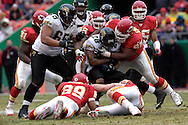 Kansas City Chiefs defensive tackle Eric Hicks (95) warps up Jacksonville running back Fred Taylor (28) for no gain in the first half at Arrowhead Stadium in Kansas City, Missouri, December 31, 2006.  The Chiefs beat the Jaguars 35-30.<br />