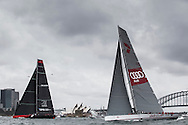 "The SOLAS Race. Sydney Harbour. Pictures of the new Maxi ""Comanche"" skippered by Ken Reed (USA and local Maxi ""Wild Oats"" rCredit: Lloyd Images"