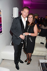 NICK CANDY and his mother PATRICIA CANDY at a party to launch the Autumn/Winter 2013 Candy Magazine held at The Saatchi Gallery, Duke of York's HQ, King's Road, London on 15th October 2013.