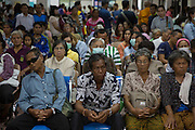 Taproom Boot, 82, (wearing sunglasses) and other patients wait for their turn to see the doctor at the weekly Melioidosis clinic at Sapphasit Prasong Provincial Hospital. Because of the severity of Meliondosis patients are required to return to hospital at least once a year for the rest of their lives. He first contracted the disease 30 years and has 3 recurrences complicated further by his diabetes.<br /> <br /> Melioidosis, though hardly heard of, is Thailand's third largest killer after AIDS and TB. Experts estimate that Melioidosis, caused by a shape-shifting bacteria that lives in water and soil, has 165,000 new cases world-wide a year and that more than half result in death. That means Melioidosis kills roughly the same number as measles or dengue across the globe. <br /> <br /> The bacteria is highly endemic in Northeast Thailand where around 2000 cases are reported per year and mostly from rice farmers who have regular contact with the soil. If not treated and the patients have other complications such a diabetes the mortality rate can be as high as 90% within 5 days.<br /> <br /> If a patient is treated, every case involves a minimum of 2 weeks in hospital followed by 20 weeks of antibiotic treatment.<br /> <br /> Melioidosis, placed in the same microorganism grouping as anthrax by the US government, is a deadly neglected tropical disease that very few have even heard of.