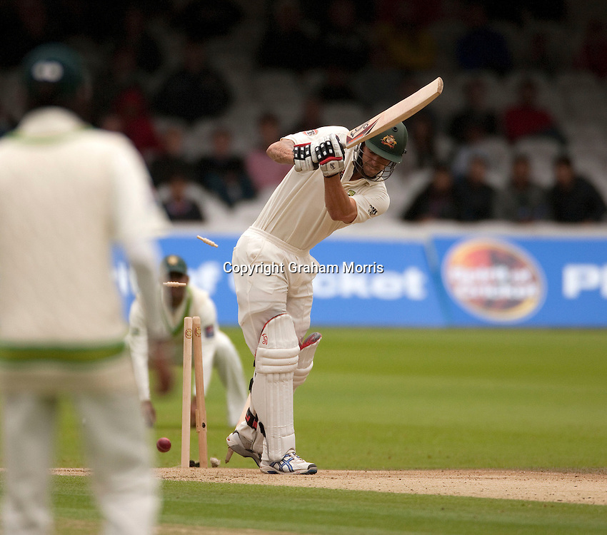 Mitchell Johnson is bowled by Umar Gul during the MCC Spirit of Cricket Test Match between Pakistan and Australia at Lord's.  Photo: Graham Morris (Tel: +44(0)20 8969 4192 Email: sales@cricketpix.com) 15/07/10