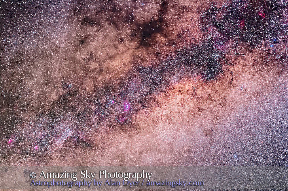 The centre of the galaxy area of the Milky Way toward Sagittarius and Scorpius, with the Sagittarius Starcloud right of centre, and the Lagoon Nebula (M8) left of centre. The Cat's Paw Nebula (NGC 6334) in Scorpius is at upper right, the Swan Nebula (M17) and Eagle Nebula (M16) are at lower left. To the right of them is the Small Sagittarius Starcloud (M24). At the very top is the Snake Nebula (B72). The main mass of dark nebula is the Pipe Nebula (B78). Above M24 at left is the open cluster M23 while below the M24 star cloud is the cluster M25. The globular M22 is at the bottom edge. At right of frame are the open clusters M6 (in the dark area of the Milky Way) and M7 (in the bright starcloud). <br /> <br /> I took this at about 3 am local time, Monday, March 31 from the Warrumbungles Motel grounds near Coonabarabran, NSW, Australia at the OzSky Star Safari 2014. This is a stack of 4 x 4 minute exposures at f/2.8 with the Sigma 50mm lens on the Canon 60Da at ISO 800. The camera was tracking the sky using the iOptron SkyTracker. <br /> <br /> I've oriented it horizontally as that's the way the camera was oriented to frame the area as it was rising in the east in the sky. However, from northern latitudes, this area would be framed vertically with the right side of the image in Scorpius (the area farthest south in the Milky Way) at bottom.
