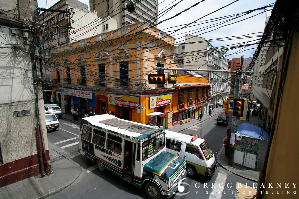 A wired intersection in downtown La Paz, Bolivia, the highest altitude capital city in the world (13,313 feet) above sea level, airport). - South America