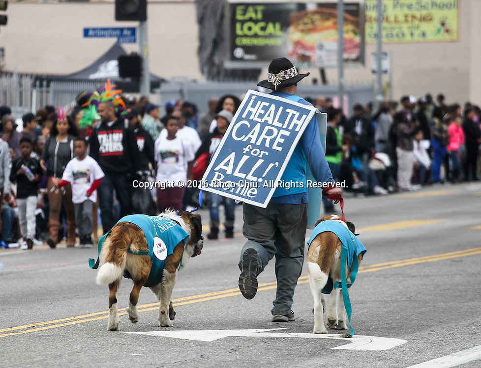 A supporter of democratic presidential candidate, Sen. Bernie Sanders, makes his way down Martin Luther King Blvd. during the Martin Luther King Jr. parade in Los Angeles on Monday Jan. 18, 2016. The 31st annual Kingdom Day Parade honoring Martin Luther King Jr. was themed &quot;Our Work Is Not Yet Done&quot;(Photo by Ringo Chiu/PHOTOFORMULA.com)<br /> <br /> Usage Notes: This content is intended for editorial use only. For other uses, additional clearances may be required.