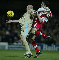 Photo: Aidan Ellis.<br /> Doncaster Rovers v Bristol City. Coca Cola League 1.<br /> 26/11/2005.<br /> Bristol's Steve Brooker holds off Doncaster's Stephen Foster