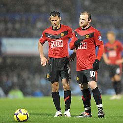 Wayne Rooney (L-Manchester United) and Ryan Giggs (Manchester United) discuss tactics before a free kick.  Portsmouth v Manchester United (1-4), Barclays Premier League Fratton Park, Portsmouth, 28th November 2009.