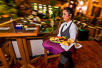 "A waitress carrying a ""fiesta platter"", El Pinto Restaurant and Cantina, Albuquerque, New Mexico USA"