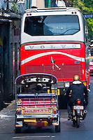 A tuk tuk (Auto rickshaw) in traffic, Bangkok, Thailand