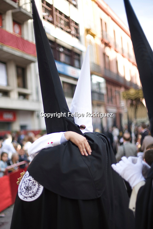 Penitents belonging to different brotherhoods embrace, Holy Week, Seville, Spain
