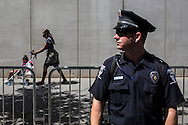 A police officer keeps watch over the March on Wall Street South protest on Sunday, September 2, 2012 in Charlotte, NC.