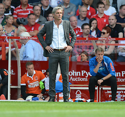 BlackPool's Manger Jose Riga stand son the touchline with his hands on his hips. - Photo mandatory by-line: Alex James/JMP - Mobile: 07966 386802 09/08/2014 - SPORT - FOOTBALL - Nottingham - City Ground - Nottingham Forest v Blackpool - Sky Bet Championship - First game of the season