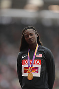 Tori Bowie, USA, 100 m gold medal podium during the IAAF World Championships 070817 at the London Stadium, London, England on 7 August 2017. Photo by Myriam Cawston.