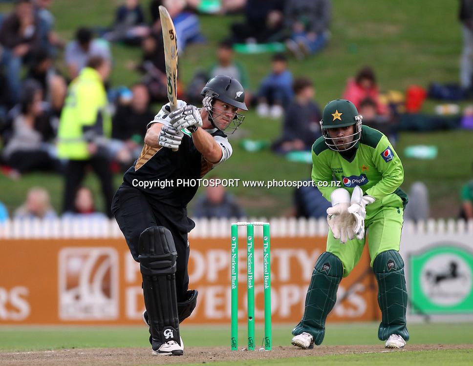 New Zealand batsman James Franklin in action batting as Umar Akmal looks on. New Zealand Black Caps v Pakistan, Match 2. Twenty 20 Cricket match at Seddon Park, Hamilton, New Zealand. Tuesday 28 December 2010. Photo: Andrew Cornaga/photosport.co.nz